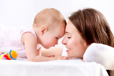 mom and child: Mother and Baby kissing and hugging  Happy Family  Stock Photo