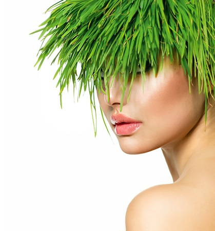Beauty Spring Woman with Fresh Green Grass Hair photo