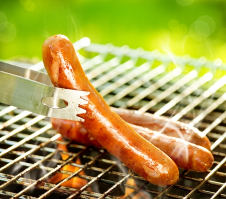 Grilled Sausage on the flaming Grill  BBQ  Bearbeque outdoors  photo