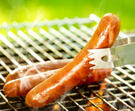 barbecue fire: Grilled Sausage on the flaming Grill  BBQ  Bearbeque outdoors