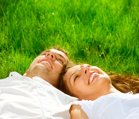 good mood: Young Couple Lying on Grass Outdoor