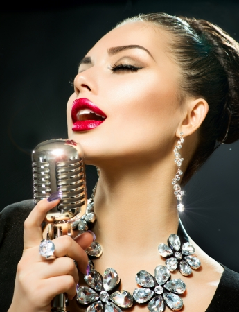 Singing Woman with Retro Microphone  Stock Photo - 19857514