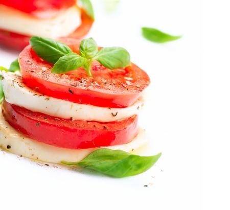 mozzarella cheese: Caprese Salad  Tomato and Mozzarella slices with basil leaves