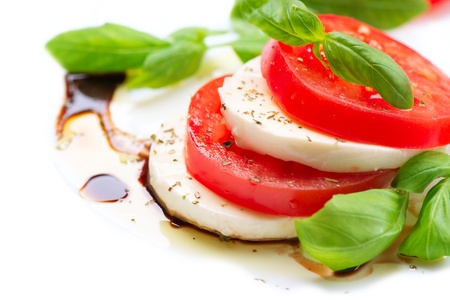 Caprese Salad  Tomato and Mozzarella slices with basil leaves