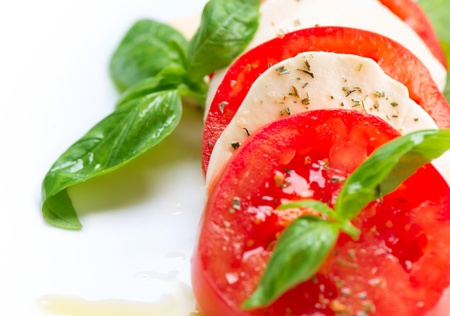Caprese Salad  Tomato and Mozzarella slices with basil leaves  photo