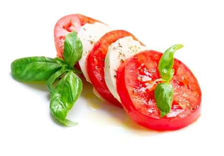 slice tomato: Caprese Salad  Tomato and Mozzarella slices with basil leaves