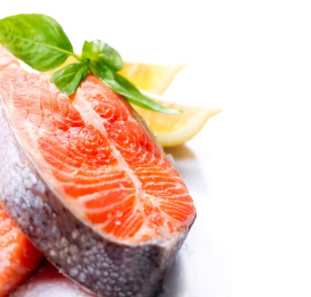 red salmon: Raw Salmon Red Fish Steak with Herbs and Lemon isolated on White  Stock Photo