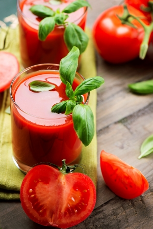 Tomato Juice and Fresh Tomatoes with Basil on a Wooden Table