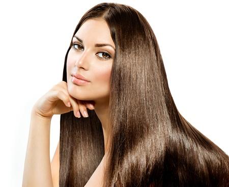 長いストレートの髪美しいブルネット少女白で隔離されます。 写真素材