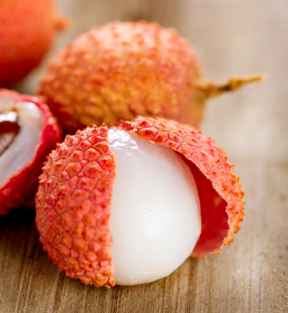 lichi: Lychee on a wooden table  Lichi Closeup  Selective focus