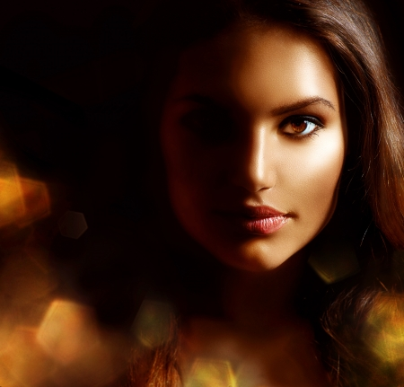 Beauty Girl Dark Portrait with Golden Sparks  Mysterious Woman  photo