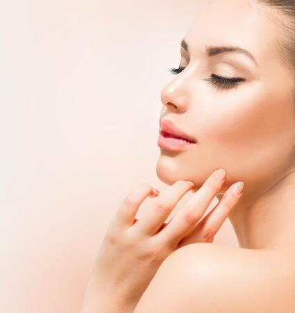 clean skin: Spa Girl  Beautiful Young Woman Touching Her Face Stock Photo