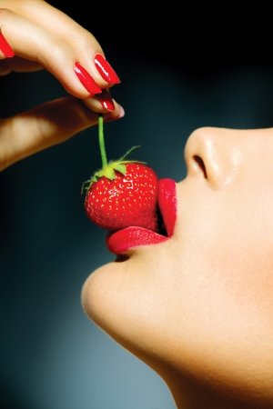 Sexy Woman Eating Strawberry  Sensual Red Lips photo