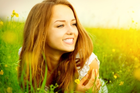 the green: Beauty Girl in the Meadow lying on Green Grass