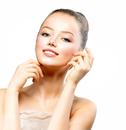 touching face: Beautiful Young Woman with Fresh Clean Skin touching her Face