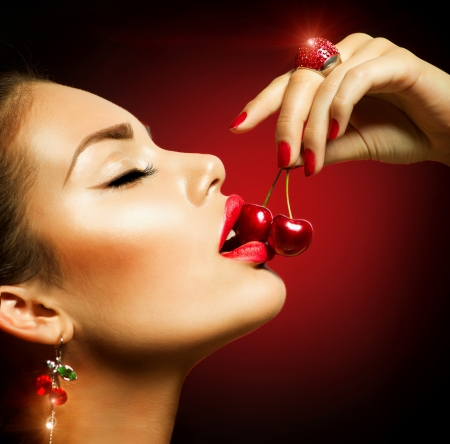 Sexy Woman Eating Cherry  Sensual red Lips with Cherries  Stock Photo - 20793574