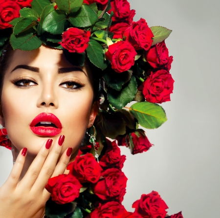 red lip: Beauty Fashion Model Girl Portrait with Red Roses Hairstyle  Stock Photo