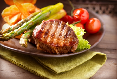 meal preparation: Grilled Beef Steak Meat with Vegetables