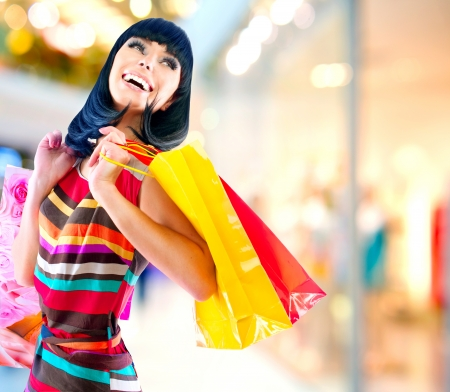 Beauty Woman with Shopping Bags in Shopping Mall  Imagens