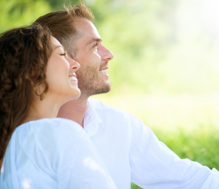 Happy Smiling Couple Relaxing in a Park  Picnic  photo