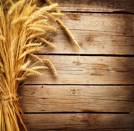 Wheat Ears on the Wooden Table  Harvest concept  Stock Photo
