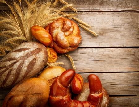 sheaf: Bakery Bread and Sheaf over Wood Background