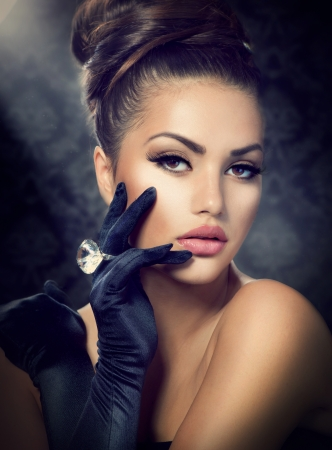 jewel hands:  Beauty Fashion Girl Portrait  Vintage Style Girl Wearing Gloves  Stock Photo