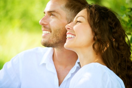 girl teeth: Happy Smiling Couple Relaxing in a Park  Picnic