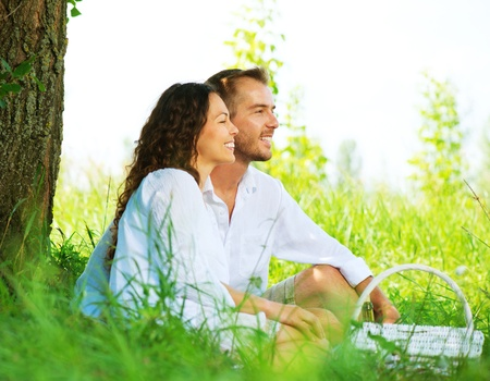 Young Couple Having Picnic in a Park  Happy Family Outdoor  photo