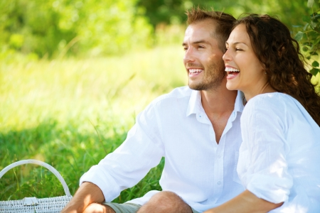 getaway: Young Couple Having Picnic in a Park  Happy Family Outdoor