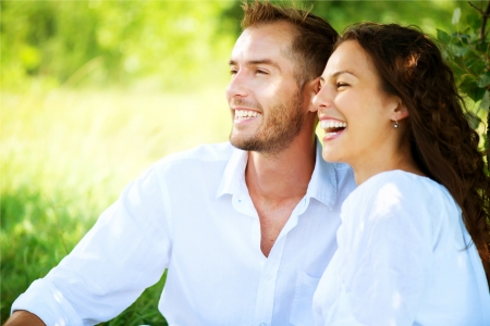 enjoying: Happy Smiling Couple Relaxing in a Park  Picnic