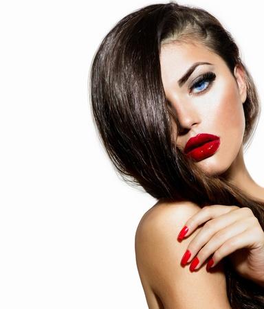 mooie vrouwen: Sexy schoonheid meisje met rode lippen en nagels Provocerende Make-up Stockfoto