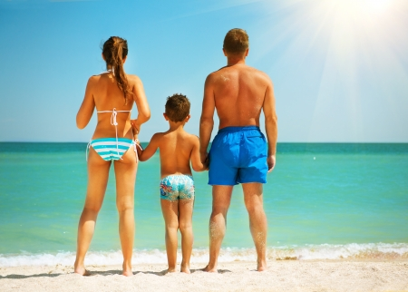 guy on beach: Happy Family Having Fun at the Beach  Summer Holidays