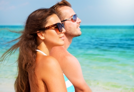 couple: Happy Couple in Sunglasses on the Beach  Summer Vacation