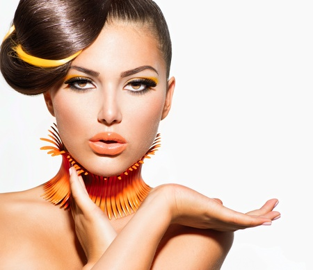 Fashion Model Girl Portrait with Yellow and Orange Makeup Stock Photo - 21289450