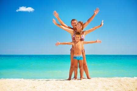 a boy: Happy Family Having Fun at the Beach  Vacation