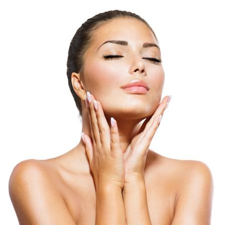mano touch: Bellezza ritratto di donna bella spa toccare il viso