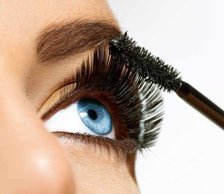Mascara aanbrengen Long Lashes closeup Stockfoto
