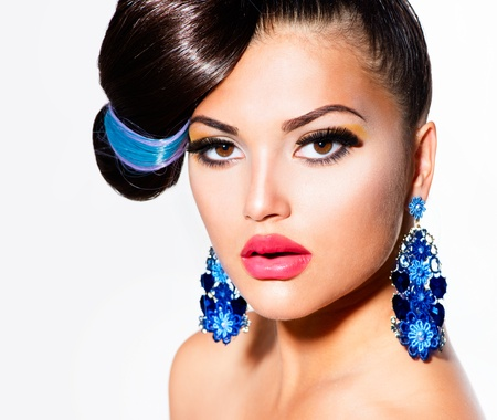 Fashion Model Girl Portrait with Brown Eyes and Blue Earrings  photo