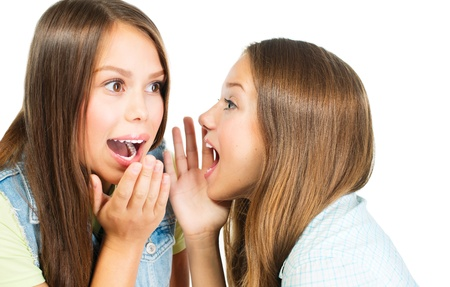 confide: Gossip  Two Teenage Girls Speaking and Sharing Secrets  Stock Photo