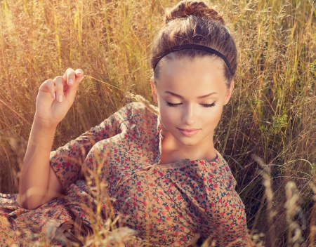 Beauty Romantic Girl Lying on the Field in Sun Light  Stock Photo