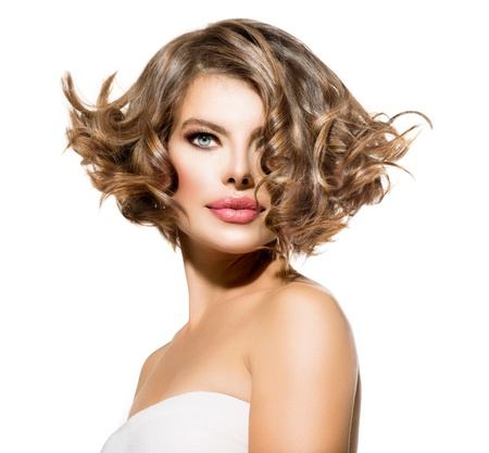 haircut: Beauty Young Woman Portrait over White  Short Curly Hair  Stock Photo