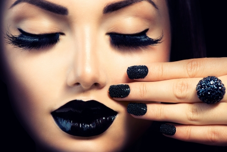 Beauty Fashion Girl with Trendy Caviar Black Manicure and Makeup