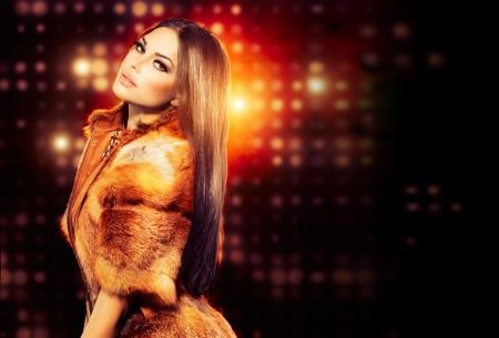 brown hair: Beauty Fashion Model Girl in Fox Fur Coat
