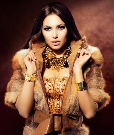 to coat: Beauty Fashion Model Girl in Fox Fur Coat