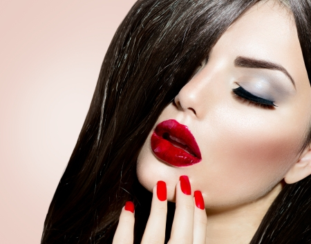 Sexy Beauty Girl with Red Lips and Nails  Provocative Make up  photo