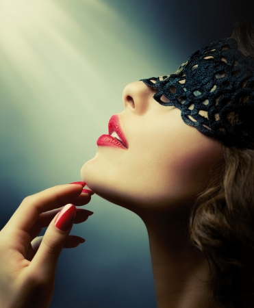 Beautiful Woman with Black Lace mask over her Eyes  photo