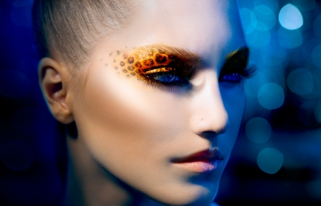 styling: Beauty Fashion Model Girl with Holiday Leopard Makeup  Stock Photo