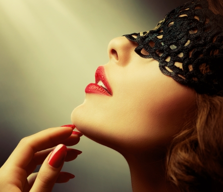Beautiful Woman with Black Lace mask over her Eyes  Stock fotó