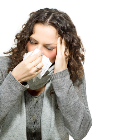 Sick Woman  Flu  Woman Caught Cold  Sneezing into Tissue  photo